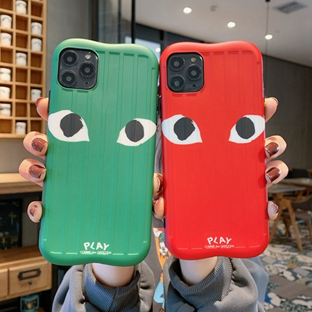 Comme des Garcons 目柄スーツケース式スマホケース